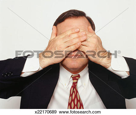 Stock Photograph of Man covering eyes with hands x22170689.