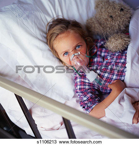Stock Photo of Child in hospital bed, wearing oxygen mask, holding.