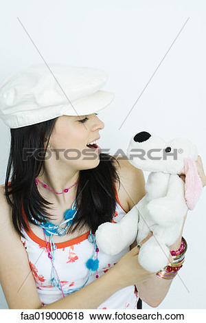 Pictures of Teen girl holding stuffed animal, portrait.