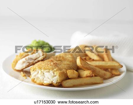Stock Photography of Plate of battered cod and chips with mushy.