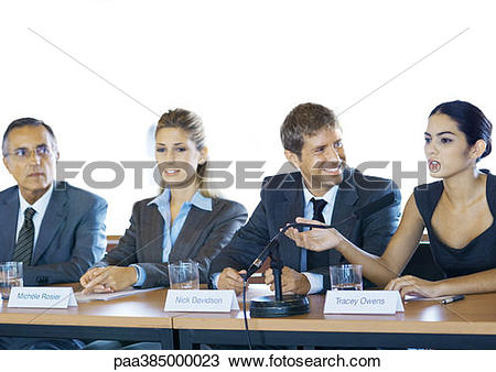 Stock Photo of Executives sitting at conference table, one woman.