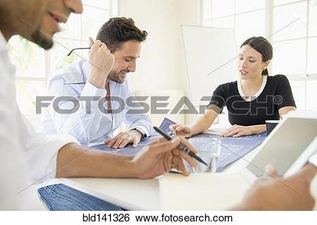 Stock Images of Business people working together at conference.