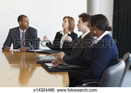 Stock Photography of Business people at conference table, woman.