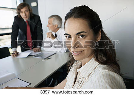 Picture of Business colleagues sitting at conference table in.