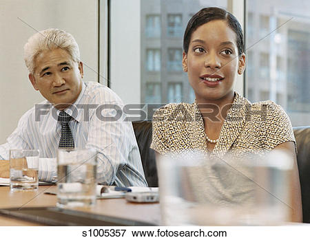 Picture of Businessman and Woman Sit Side.