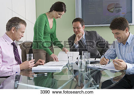 Stock Photography of Business colleagues sitting at conference.