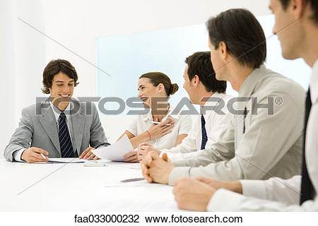 Stock Photo of Group of business associates sitting together at.