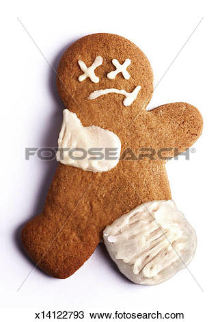 Stock Photo of Cookie shaped as a sad broken gingerbread man.
