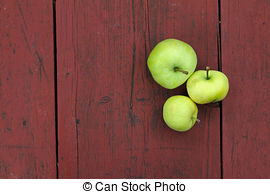 Stock Photo of Red delicious apples on old school desk csp2046362.