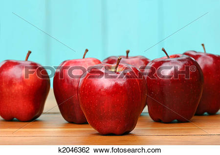 Stock Photo of Red delicious apples on old school desk k2046362.
