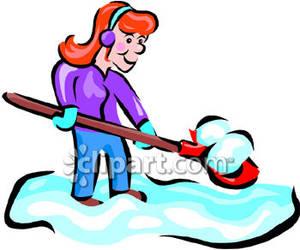 Woman Using A Snow Shovel.