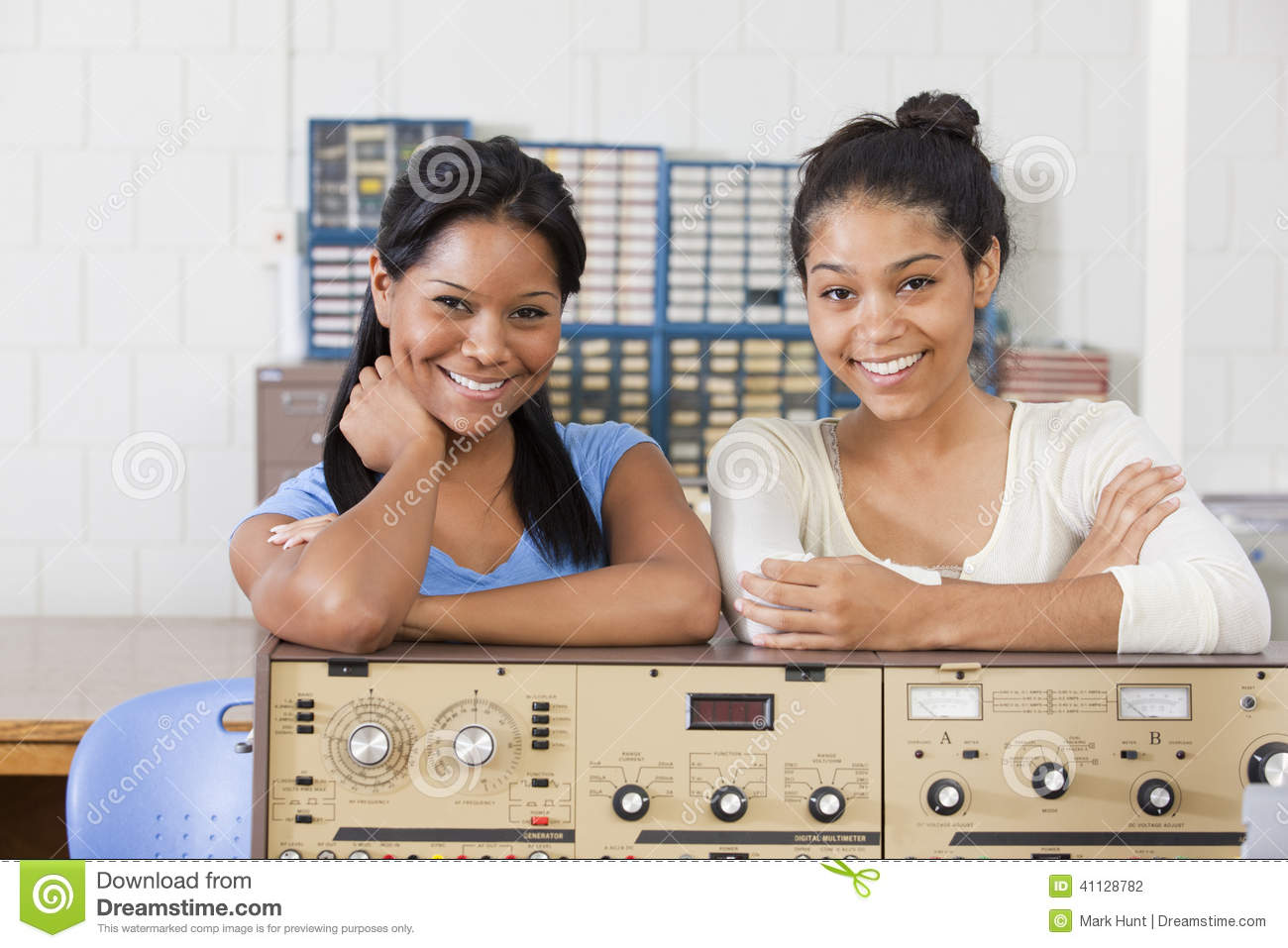 Female Engineering Students At Test Bench Stock Photo.