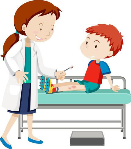 Doctor helping young boy with sore leg.