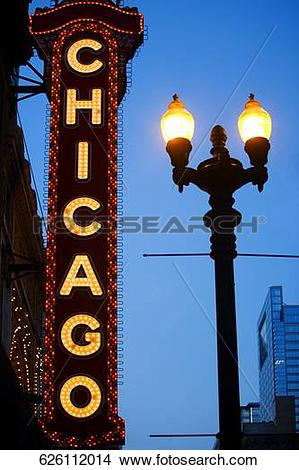 Stock Photo of Low angle view of Chicago neon sign lit up at dusk.