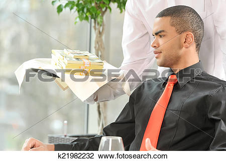 Stock Photo of man sitting in restaurant and looking at money.