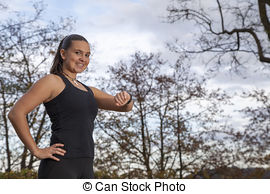Stock Images of Woman checking time on her watch csp8231495.