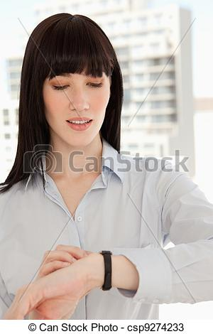 Stock Photos of Close up of a woman checking the time on her watch.