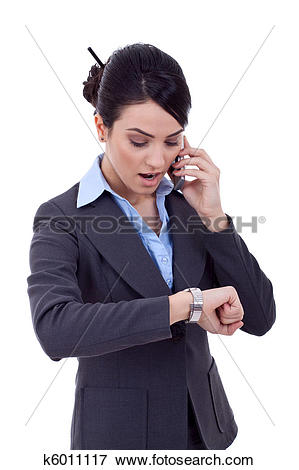 Picture of woman checking the time while calling. k6011117.
