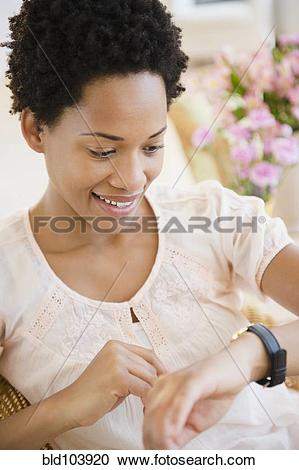 Stock Photography of African American woman checking the time.