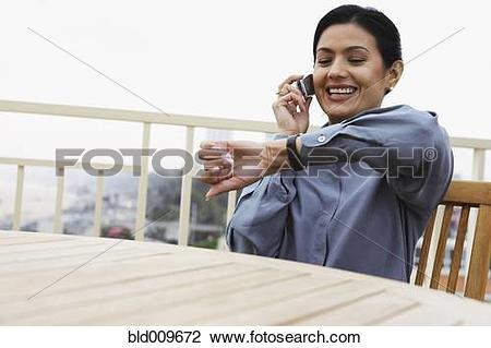Stock Photo of Woman checking the time on her watch bld009672.