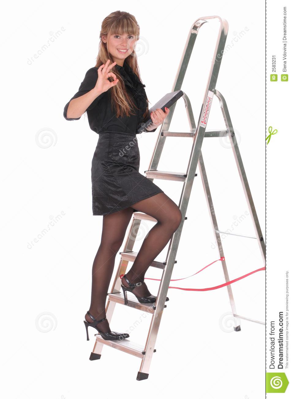 Business Woman Climbing Ladder Stock Image.