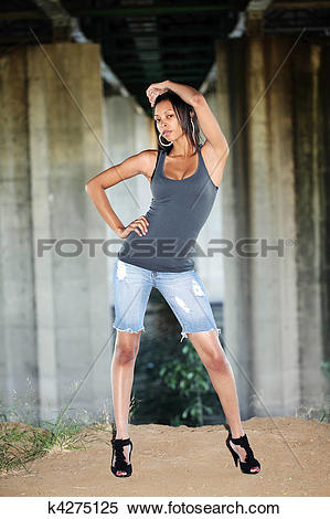 Stock Image of Young black woman in jeans cutoff shorts k4275125.