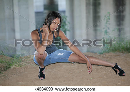 Stock Photography of Young African American woman in cutoff jeans.
