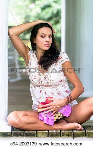Stock Photograph of A 27 year old brunette woman wearing cut off.