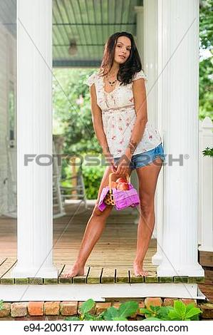 Picture of A 27 year old brunette woman wearing cut off shorts.