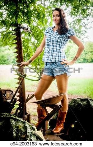 Stock Photo of A 27 year old brunette woman wearing cut off shorts.