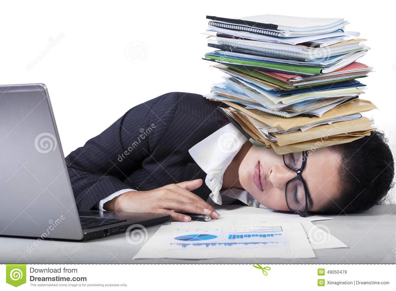 Overworked Indian Woman Sleeping On Desk Stock Photo.