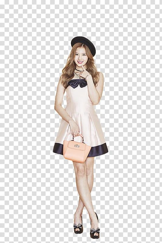 Twice, woman standing holding handbag transparent background.