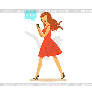 Young woman walking and sending message to someone.