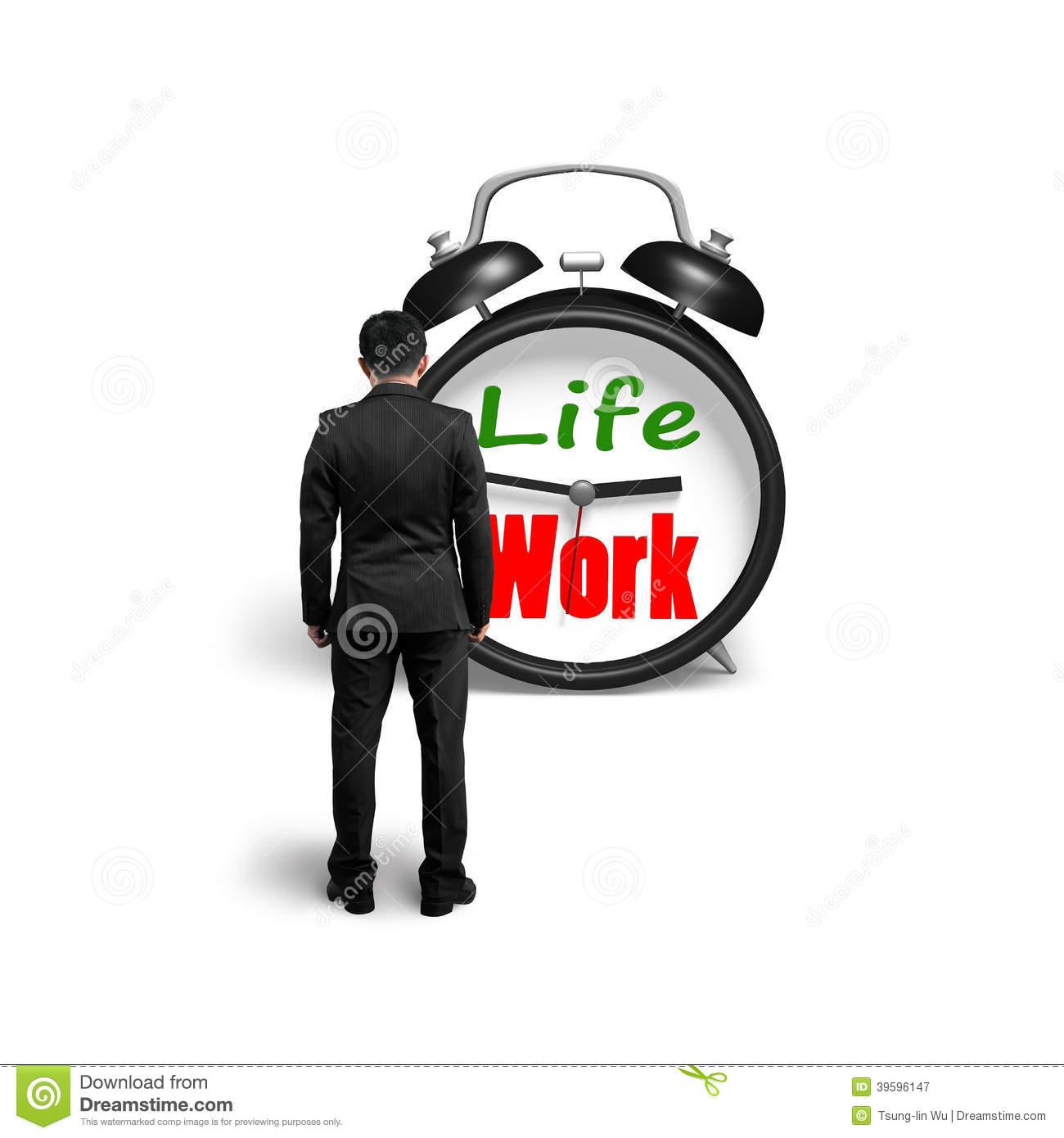 Man Facing Alarm Clock With Life And Work Face Stock Photo.