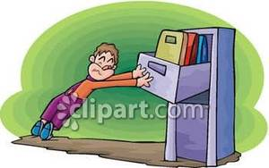 Man Struggling To Close a File Cabinet.