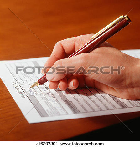 Stock Photography of Man filling in application form, Close.