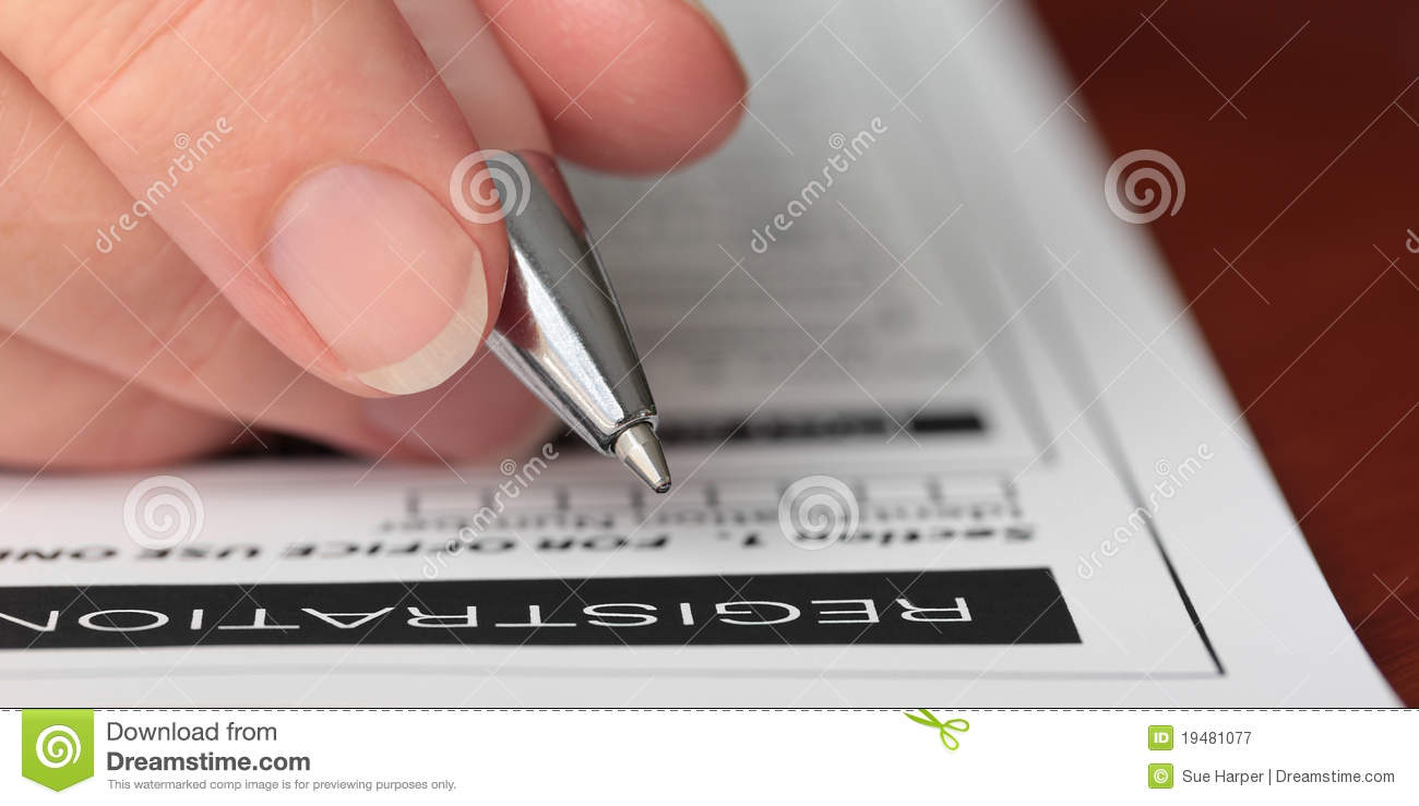 Hand With Pen Filling Out A Form Closeup Royalty Free Stock.