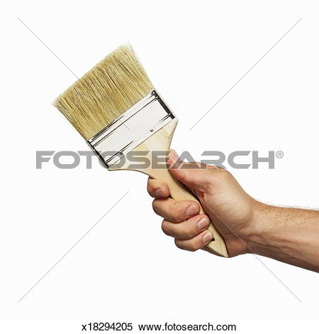 Stock Image of close up view of a hand holding a paintbrush.