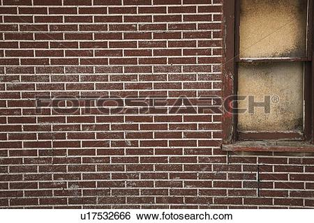 Stock Images of alberta, canada; a red brick wall with a boarded.