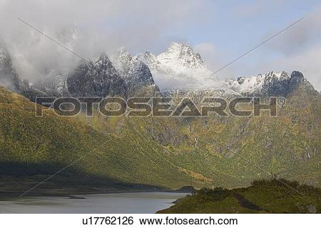 Stock Images of Cloud cover on mountains, Lofoten Islands, Norway.