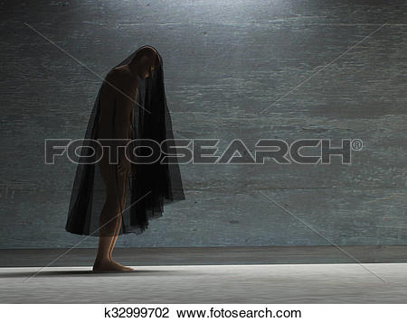 Stock Photo of Figure hunched over under transparent cloth.