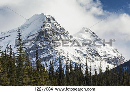 Stock Photo of Close up of two snow covered mountain peaks with.