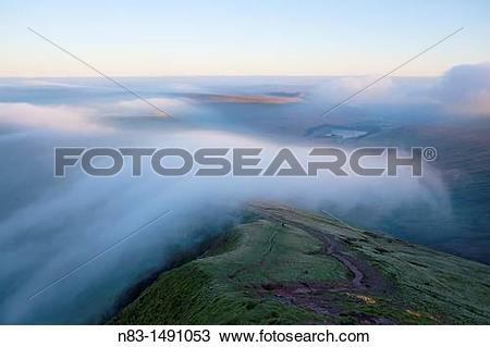 Stock Photo of Orographic cloud forms around the summit of Pen.