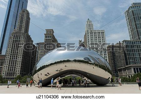 Stock Images of Reflection of buildings on Cloud Gate sculpture.