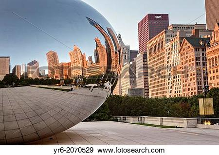 Stock Photograph of Cloud Gate Sculpture or The Bean with downtown.