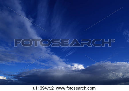Stock Photo of Layers Of Thin Cloud Wisps In A Clear Blue Sky.