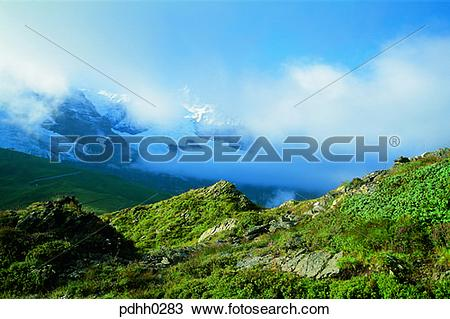 Stock Photo of suburb, suburb district, cloud, mountain covered by.