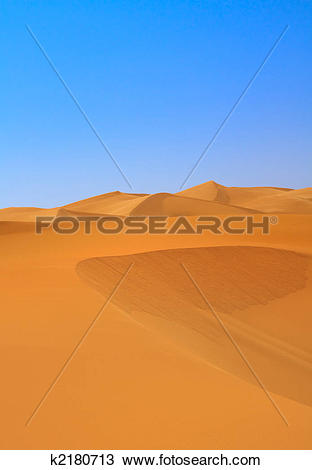 Stock Photo of sand dunes and cloudless sky k2180713.