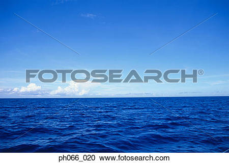 Stock Photography of Surface of blue sea to clouds on horizon.