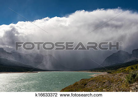 Stock Photo of Storm clouds gathering over Lake Sherburne.